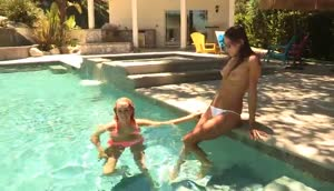 Two Lesbian Babes Gets Naughty In A Pool